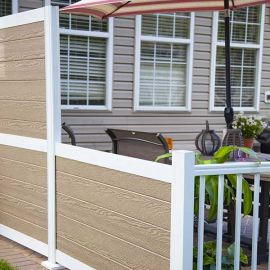 The HideAway Privacy Rail Vinyl Infill Panels, shown in Earth, provide some privacy for your summer barbeques and backyard parties.
