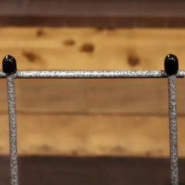 Black Hog Tusks shown on a silver welded mesh panel