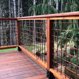 Tahoe Woven Mesh Railing Panels by Wild Hog Products in a raw steel provide security and style.
