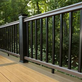 The RadianceRail composite system shown in Kona with black composite balusters and post sleeves.