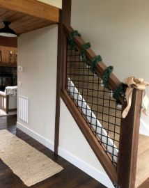 The Smoky Mountain Hog Railing Stair Panel creates an understated look for your staircase railing, both inside and out!