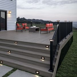 Complete your deck stairs with Deckorators Voyage Riser Boards, shown in the Sierra finish.