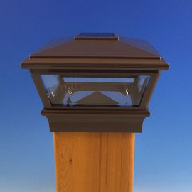 Featuring a universal Bronze finish, the Solar VersaCap Post Cap Light by Deckorators can blend with nearly any deck railing style.