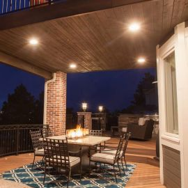 Illuminate your lower level patio area with the Trex Soffit Light for the Trex RainEscape deck drainage system.