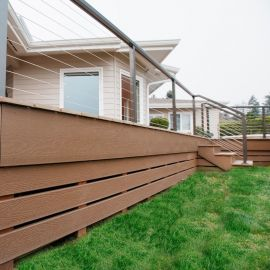 Complete the look of your new deck with Envision Fascia Boards, shown in Weathered Wood.
