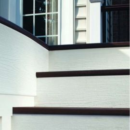 Woodgrain White Riser Boards by Trex create a perfect and crisp design for your deck's stairs.