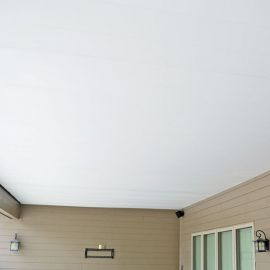 Zip-Up UnderDeck Panels in a White smooth finish opens up an outdoor space that looks natural and is completely waterproof.