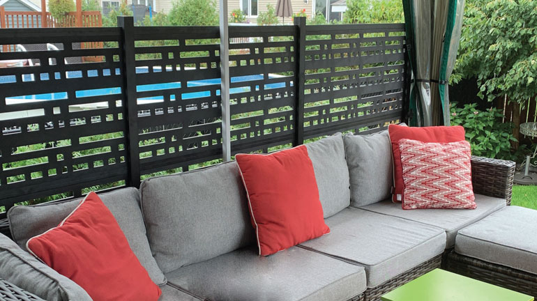 A privacy wall can provide shade as well as block unwanted views.