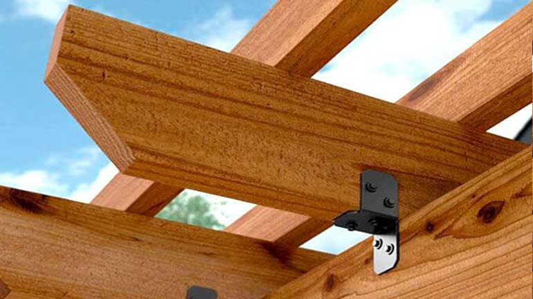 A close-up of joists attached to a pergola.