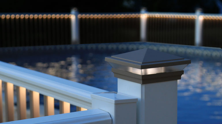 Post Cap Lights accenting a pool patio
