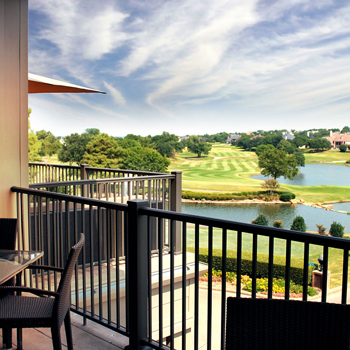 Looking out over a golf course from a patio with Afco Pro 300 Series Railing
