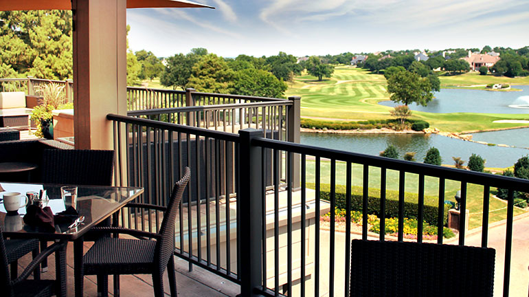 a patio of a golf club featuring Afco Pro 300 Aluminum Railing