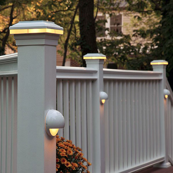 White railing with Saturn LED Post Cap Light and Nebula eyeball light