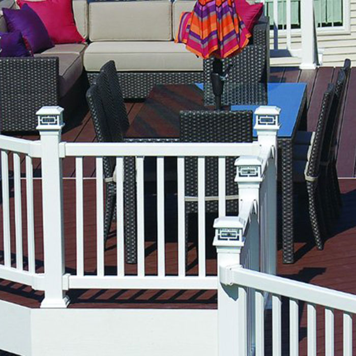 Vinyl Railing on a large composite backyard deck features white Orion Post Cap Lights from Aurora Deck Lighting