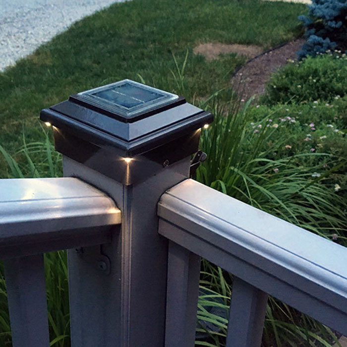 Aurora Aries Solar Post Cap Deck Light in bronze on corner stair post