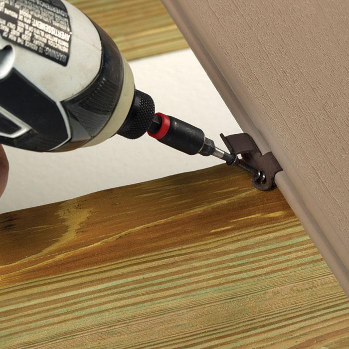 closeup of drill installing AZEK hidden fasteners