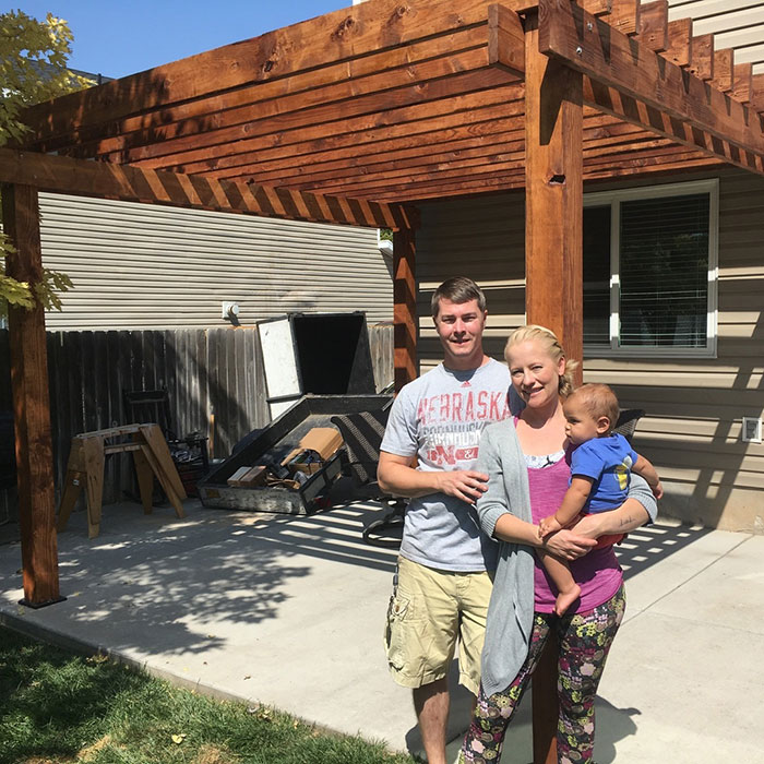 Customer photos family standing in front of their new pergola