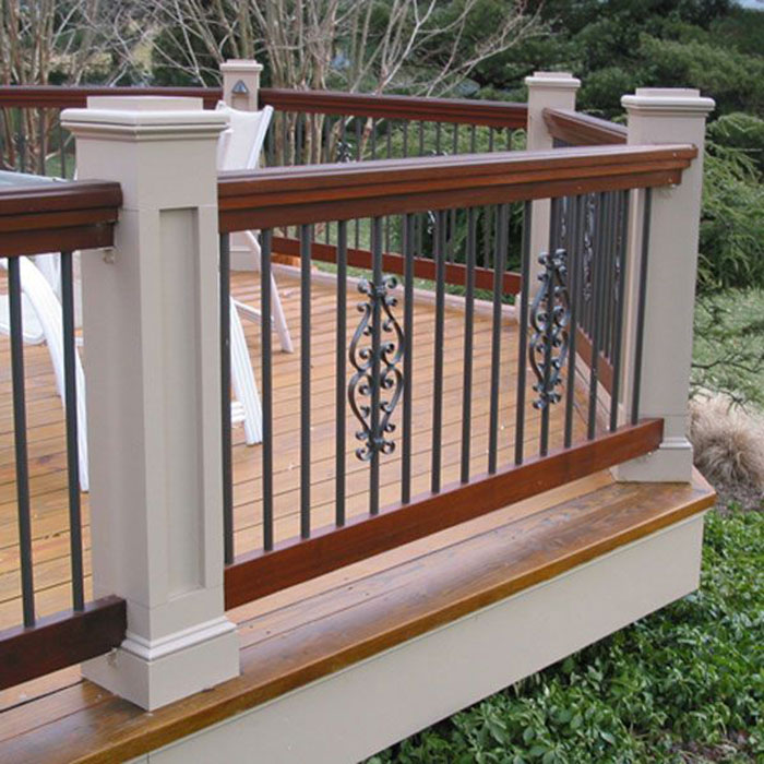 Custom deck railing with Deckoratos Classic Round Aluminum Balusters in black and matching Classical Centerpiece in Black