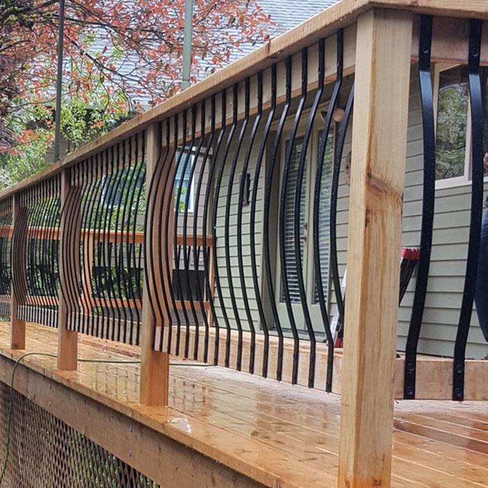 a cedar deck with Deckorators Arc Balusters