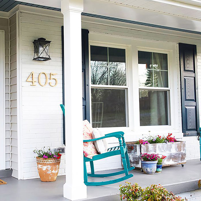 Afco Column on porch with vintage decor and rocking chairs