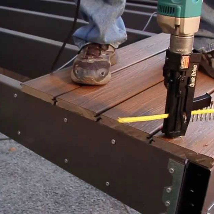 a contractor using a standup screw gun to install metal deck framing