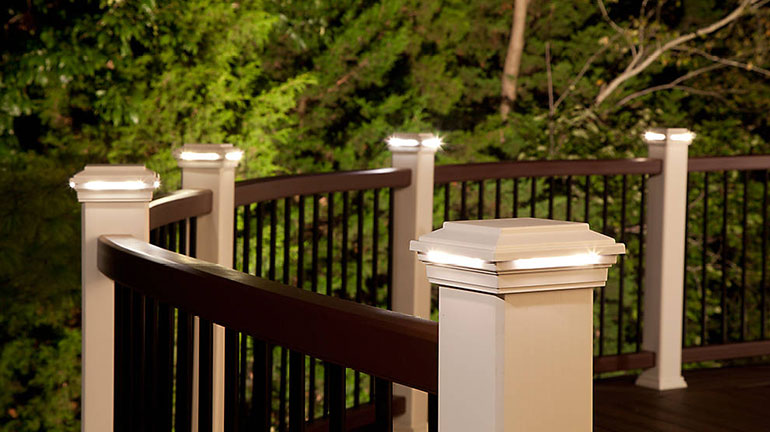 Trex Trascend curved railing with white post cap lights