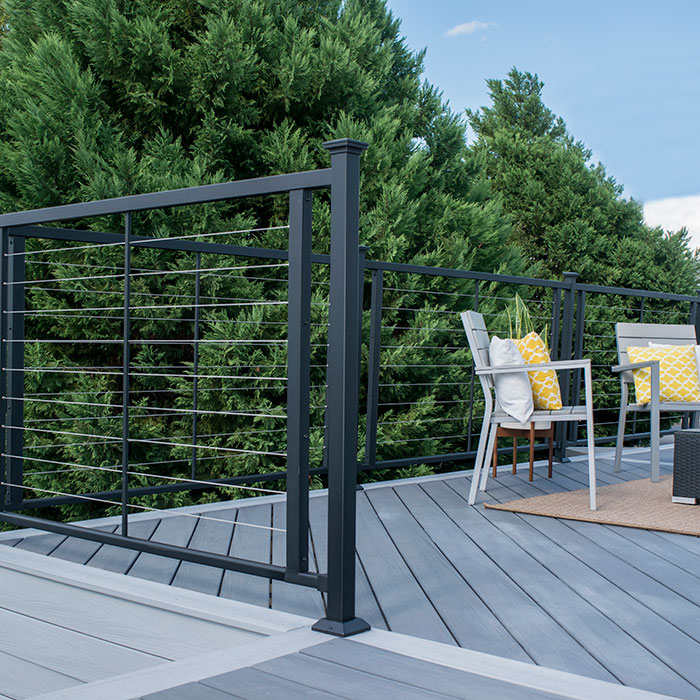 Fortress Horizontal Cable Railing in Black with modern deck furniture on a grey deck