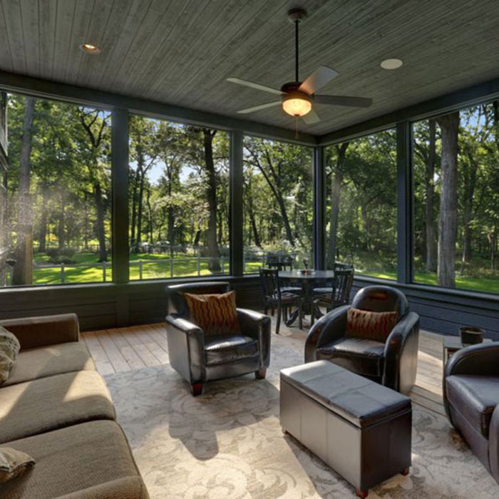 a deck with furnature and ceiling fan featuring ScreenEZE deck screen kits