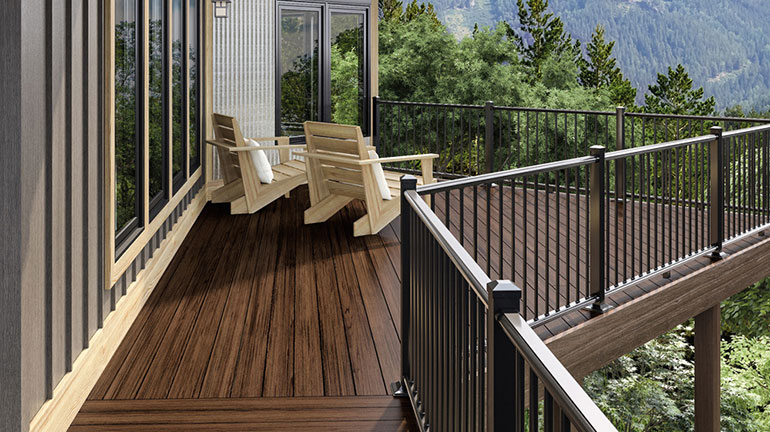 a mountain home deck with a view featuring Deckorators Heritage Riverhouse decking with Deckorators ALX Aluminum Railing in black