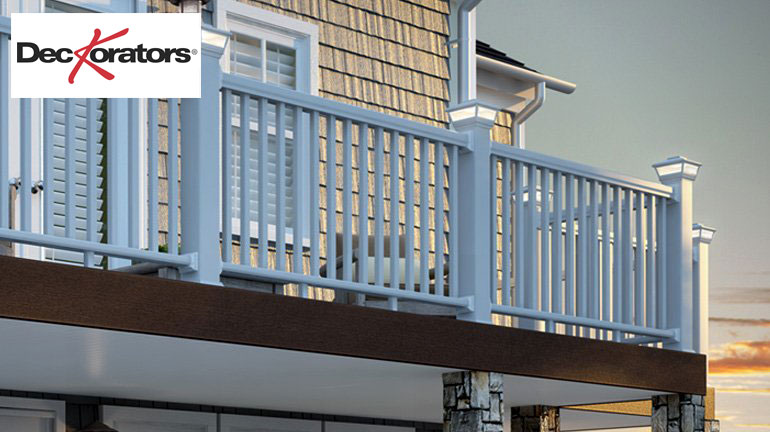 A balcony supported by columns wrapped in Deckorators Cast Stone Post Covers features CXT Classic Railing in white with solar post cap lights