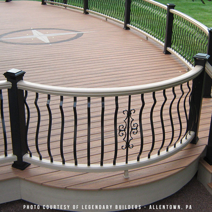 Custom curved deck railing with Deckorators Baroque Balusters and Deckorators Fieur-de-Lis Baluster Centerpiece.