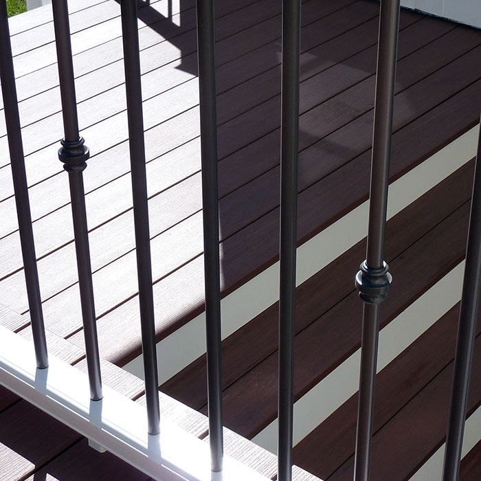Deckorators Collar Accessory for Aluminum Round Baluster in bronze on white railing
