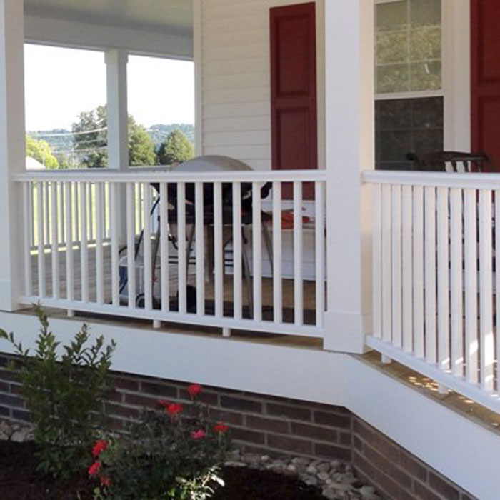 Wraparound porch with Deckorators CXT Pro Composite Railing in white featuring Colonial Style Top Rail installed between square columns with square composite balusters