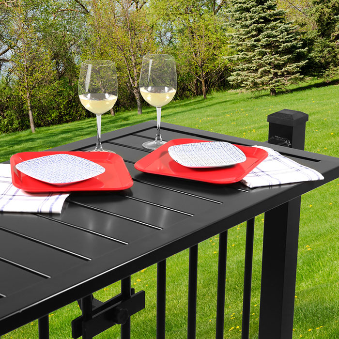 Deckorators Deck Rail Table in Black on railing with a view of the countryside in the distance