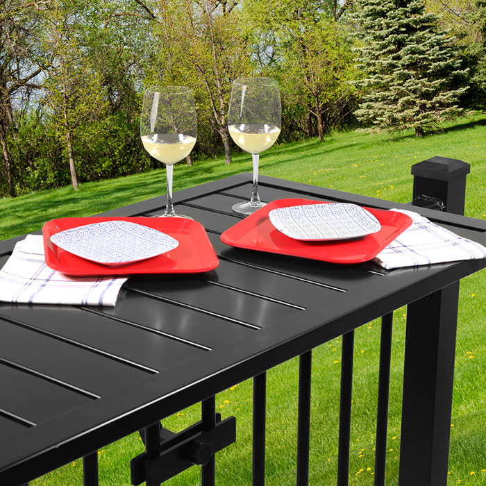 Deckorators Deck Rail Table in black with table setting and wine glasses