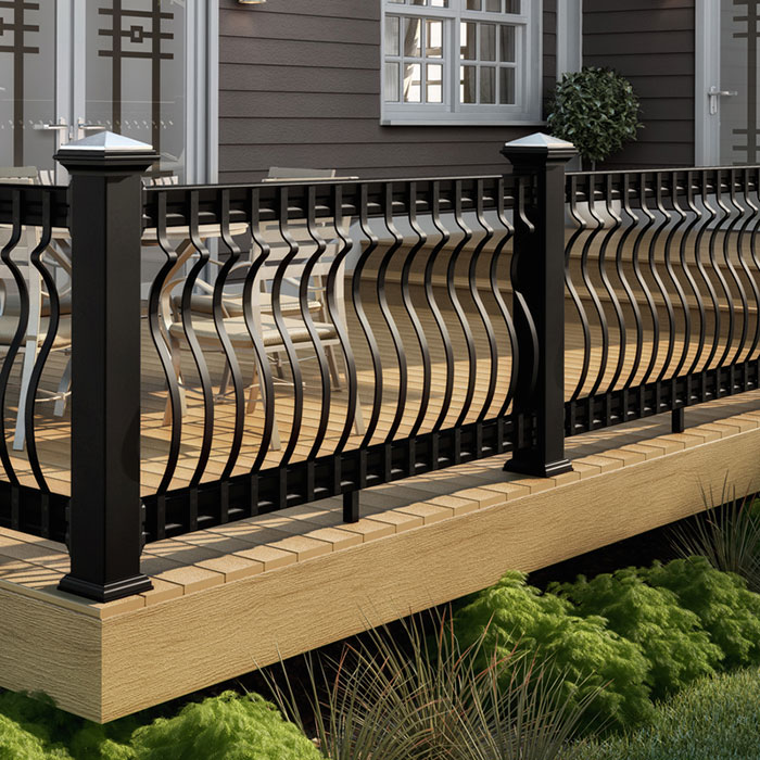 Deckorators Vista Sandalwood decking with black CXT Architectural railing, black Baroque balusters and black Stylepoint post caps with stainless tops
