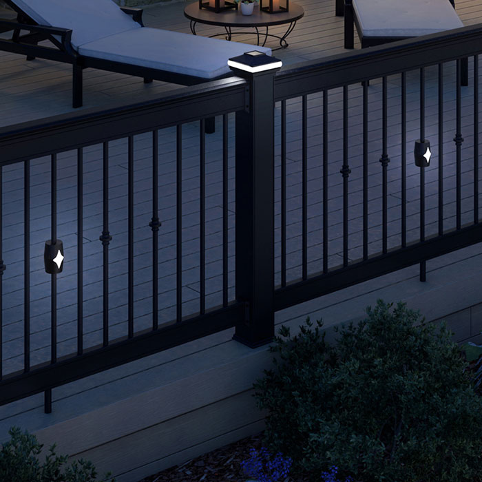 Deckorators Solar Baluster Light for Round Baluster on a deck railing at night