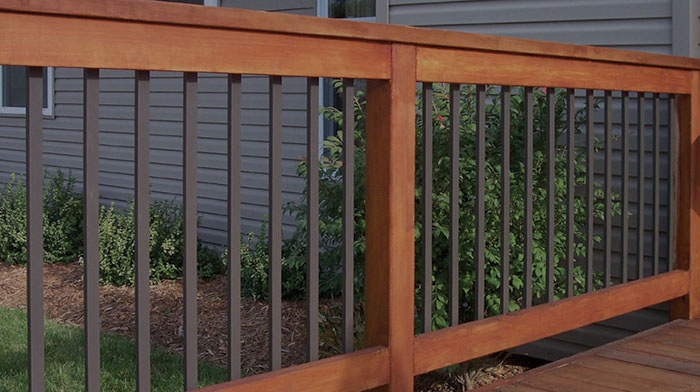 a wood deck railing with Deckorators Traditional Face-Mount Aluminum Balusters