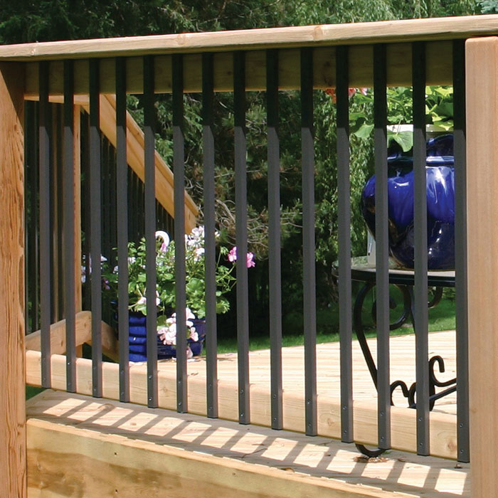 Traditional Face-Mount Aluminum Balusters by Deckorators installed on a wood railing