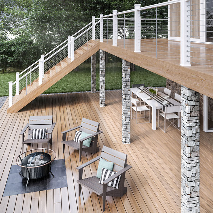 Deckorators Cable Railing on with White posts on a second story deck ing the rain