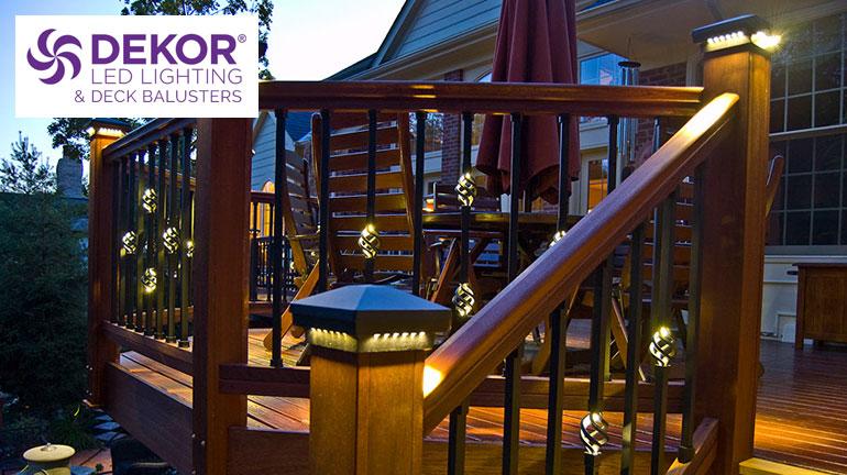 a wooden deck complete with Dekor Post Cap Lights and Dekor Lit balusters