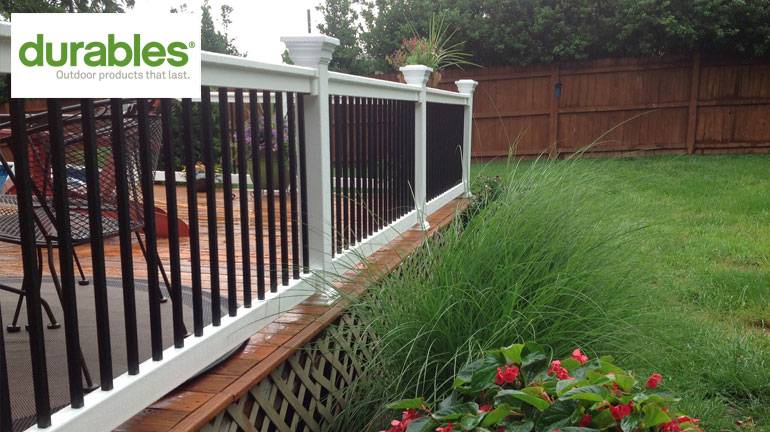 a porch with Fairway V220 Series Contour Vinyl Rail