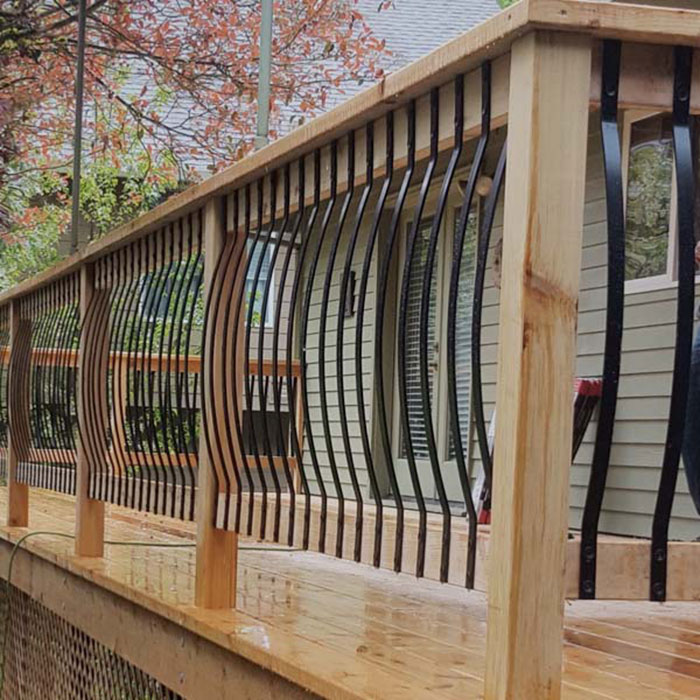 Close up of Deckorators Round Level Baluster Conntector installed on a cedar rail