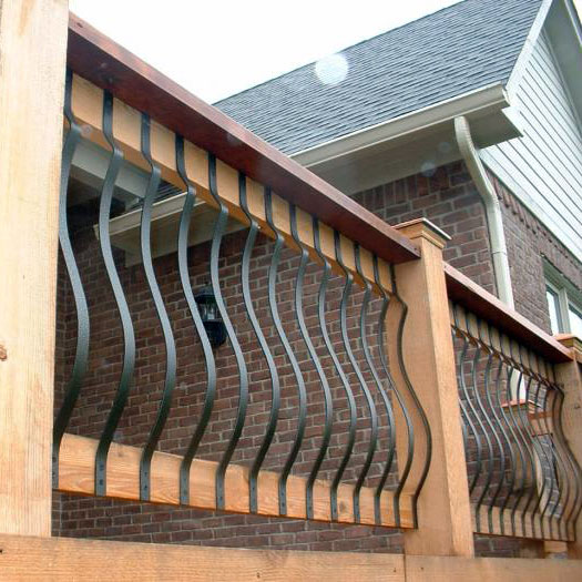 Fortress Vienna Series Face-Mount Belly Balusters on a cedar deck