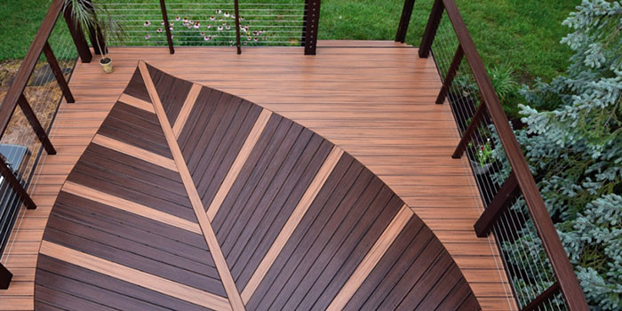 arial view of a composite deck with leaf on it and Feeney CableRail railing