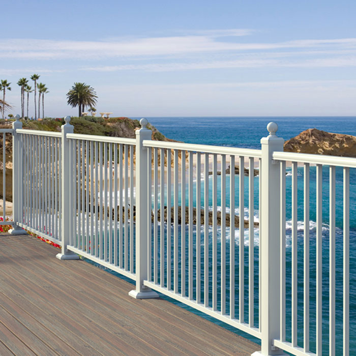 Seaside deck featuring white Fortress AL13 aluminum rail panels in white with ball top post caps