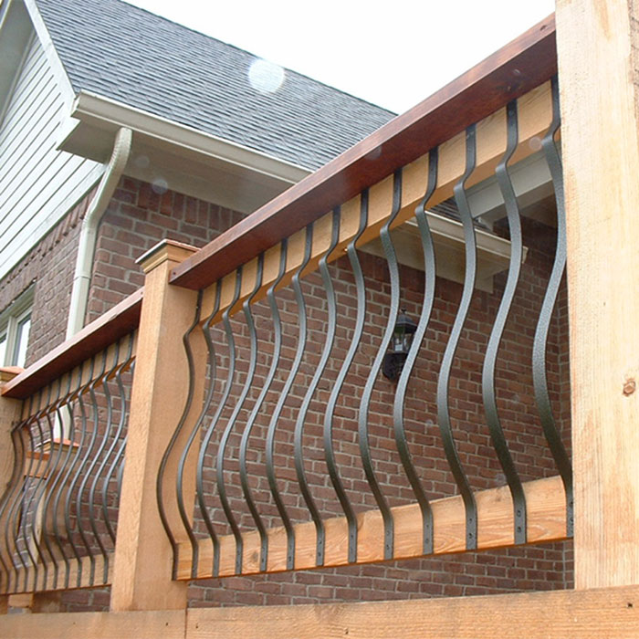 Ground view of second story deck with Fortress Iron Vienna Series Face-mount belly balusters installed with a wood railing