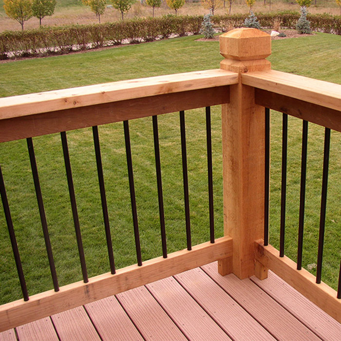 Vintage Series Round Balusters by Fortress in Gloss black installed on a cedar railing