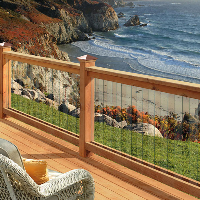Deckorators Frontier Glass Balusters in Cedar railing on a deck overlooking the sea