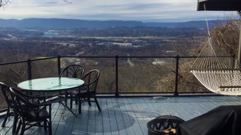 View of Tennesee landscape from a gray deck featuring Black Fine Texture Westbury Veranda Glass Railing